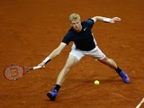 Kyle Edmund of Great Britain hits a forehand during the singles match against David Goffin of Belgium on day one of the Davis Cup Final 2015 at Flanders Expo on November 27, 2015 in Ghent, Belgium.