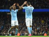 Manchester City's Serbian defender Aleksandar Kolarov (R) celebrates with Manchester City's English midfielder Fabian Delph after scoring during the English Premier League football match between Manchester City and Southampton at The Etihad stadium in Man