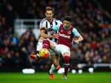 Mauro Zarate of West Ham United holds off Craig Dawson of West Bromwich Albion during the Barclays Premier League match between West Ham United and West Bromwich Albion at Boleyn Ground on November 29, 2015 in London, England.