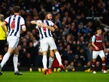 Rickie Lambert of West Bromwich Albion celebrates with Claudio Yacob (5) as his shot deflects off of Winston Reid of West Ham United for their equalising goal during the Barclays Premier League match between West Ham United and West Bromwich Albion at Bol