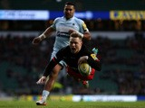Chris Ashton of Saracens dives over to score a try during the Aviva Premiership match between Saracens and Worcester Warriors at Twickenham Stadium on November 28, 2015