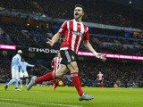 Southampton's Irish striker Shane Long celebrates after scoring during the English Premier League football match between Manchester City and Southampton at The Etihad stadium in Manchester, north west England on November 28, 2015