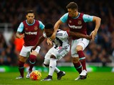 Stephane Sessegnon of West Bromwich Albion holds off Aaron Cresswell of West Ham United during the Barclays Premier League match between West Ham United and West Bromwich Albion at Boleyn Ground on November 29, 2015 in London, England.