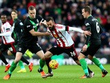Steven Fletcher (C) of Sunderland competes for the ball against Ryan Shawcross (L) and Glenn Whelan (R) of Stoke City during the Barclays Premier League match between Sunderland and Stoke City at Stadium of Light on November 28, 2015