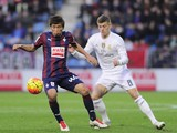Eibar's Japanese midfielder Takashi Inui (L) vies with Real Madrid's German midfielder Toni Kroos (R) during the Spanish league football match SD Eibar vs Real Madri