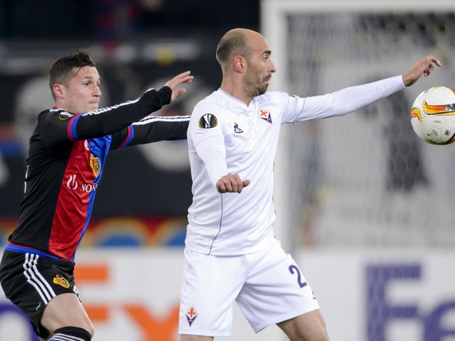 Fiorentina's Spanish midfielder Borja Valero (R) challenges Basel's Swiss midfielder Taulant Xhaka during the UEFA Europa League group I football match between Basel and Fiorentina at the St Jakob stadium in Basel on November 26, 2015.