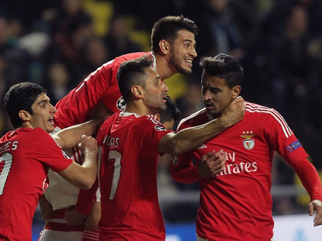 Benfica's players celebrate a goal during the UEFA Champions League group C football match between FC Astana and SL Benfica at the Astana Arena stadium in Astana on November 25, 2015.