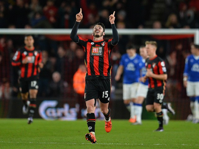Bournemouth's English defender Adam Smith celebrates scoring his team's first goal during the English Premier League football match between Bournemouth and Everton at the Vitality Stadium in Bournemouth, southern England on November 28, 2015
