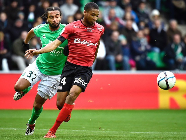 Guingamp's French defender Marcus Coco (R) vies for the ball against Saint-Etienne's French defender Benoit Assou-Ekotto (L) during the French L1 football match AS Saint-Etienne (ASSE) vs Guingamp on November 29, 2015, at the Geoffroy Guichard Stadium in