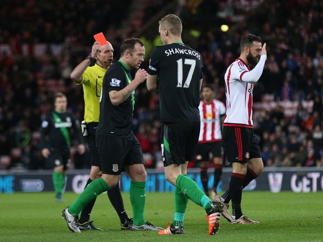 Ryan Shawcross (2nd R) of Stoke City is shown a red card by referee Mike Dean (1st L) during the Barclays Premier League match between Sunderland and Stoke City at Stadium of Light on November 28, 2015
