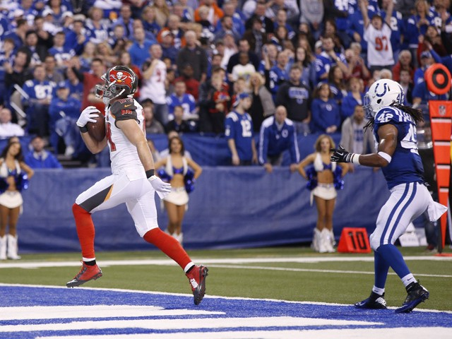 Cameron Brate #84 of the Tampa Bay Buccaneers runs into the end zone with a 20-yard touchdown reception against the Indianapolis Colts in the second quarter of the game at Lucas Oil Stadium on November 29, 2015