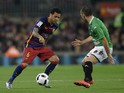 Barcelona's Brazilian defender Dani Alves (L) vies with Villanovense's midfielder Anxo (R) during the Spanish Copa del Rey (King's Cup) Round of 32 second leg football match FC Barcelona vs CF Villanovense at the Camp Nou stadium in Barcelona December 2,