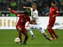 Monchengladbach's Swiss defender Nico Elvedi and Bayern Munich's midfielder Coman (L) vie for the ball during the German first division Bundesliga football match Monchengladbach vs Bayern Munich in Monchengladbach on December 5, 2015