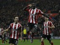 Southampton's Senegalese midfielder Sadio Mane (C) celebrates scoring his team's first goal, with Southampton's German-born Portuguese defender Cedric Soares (L) and Southampton's Northern Irish midfielder Steven Davis during the English League Cup quarte