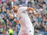 Karim Benzema of Real Madrid celebrates after scoring his team's opening goal during the La Liga match between Real Madrid CF and Getafe CF at Estadio Santiago Bernabeu on December 5, 2015