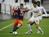 Montpelliers French forward Ryad Boudebouz (L) vies with Marseille's Spanish defender Javier Manquillo during the French L1 football match Olympique de Marseille against Montpellier on December 6, 2015 at Velodrome Stadium in Marseille, southern France.