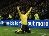 Odion Ighalo of Watford celebrates scoring his team's second goal during the Barclays Premier League match between Watford and Norwich City at Vicarage Road on December 5, 2015