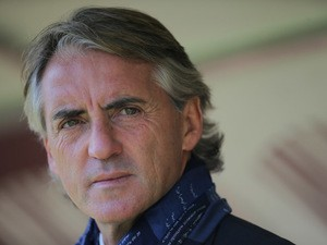 Inter Milan's coach Roberto Mancini looks on during the Italian Serie A football match Torino Vs Inter Milan on November 8, 2015