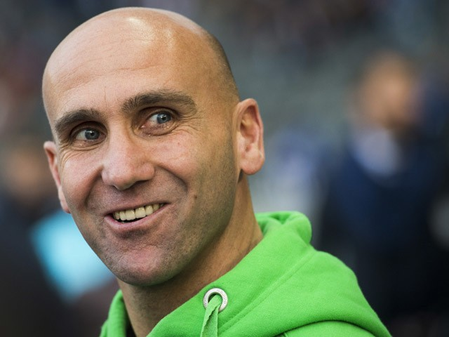 Monchengladbach head coach Andre Schubert watches the warm-up prior to the German first division Bundesliga football match Hertha BSC Berlin vs Borussia Monchengladbach at the Olympic Stadium in Berlin, on October 31, 2015
