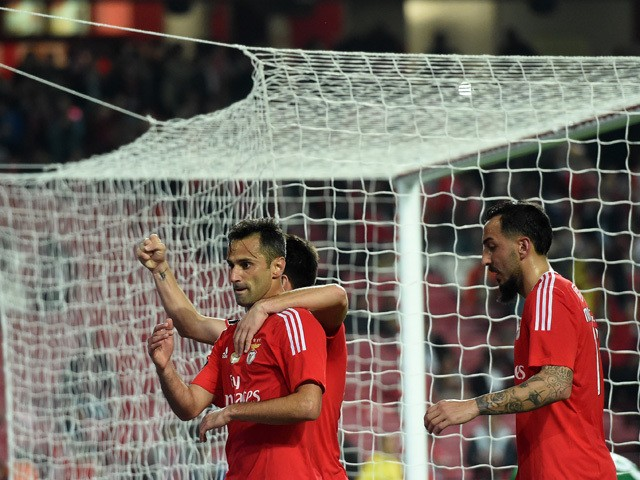 Benfica's Brazilian forward Jonas (L) celebrates with teammates after scoring the opening goal during the Portuguese league football match SL Benfica vs Ass Academica de Coimbra at the Luz stadium in Lisbon on December 4, 2015