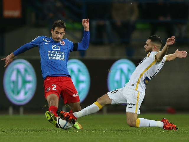 Caen's French midfielder Nicolas Seube (L) vies with Lille's French midfielder Marvin Martin during the French L1 football match between Caen (SMC) and Lille (LOSC), on December 5, 2015, at the Michel d'Ornano stadium, in Caen, northwestern France.