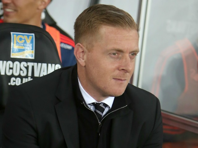 Swansea Citys English manager Garry Monk sits in the dugout during the English Premier League football match between Swansea City and Leicester City at The Liberty Stadium in Swansea, south Wales on December 5, 2015.