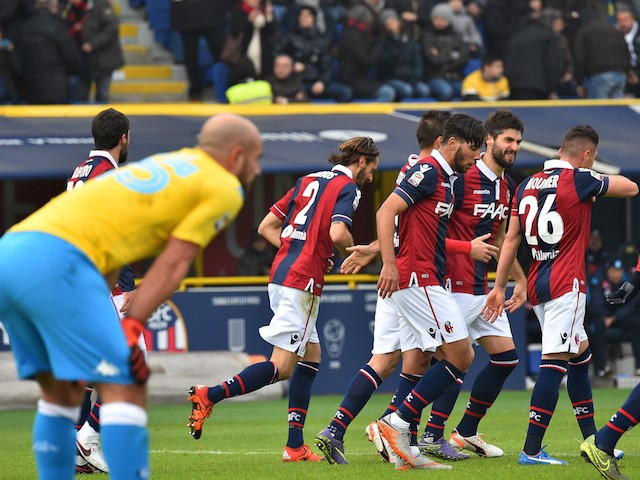 Bologna's defender from Italy Luca Rossettini (C) celebrates with teammates after scoring during the Italian Serie A football match Bologna vs Napoli at the Dall'Ara stadium in Bologna on December 6, 2015.