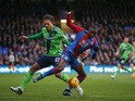 Yannick Bolasie of Crystal Palace and Virgil van Dijk of Southampton compete for the ball during the Barclays Premier League match between Crystal Palace and Southampton at Selhurst Park on December 12, 2015
