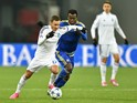 Dynamo's midfielder Serhiy Rybalka (L) evades Maccabi's Nigerian midfielder Nosa Igiebor during the UEFA Champions League Group G football match between FC Dynamo Kiev and Maccabi Tel-Aviv on December 9, 2015 at the Olympic stadium in Kiev.
