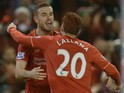 Liverpool's English midfielder Jordan Henderson (L) celebrates with Liverpool's English midfielder Adam Lallana (R) after scoring the opening goal during the English Premier League football match between Liverpool and West Bromwich Albion at Anfield in Li