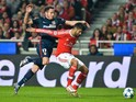Atletico Madrid's midfielder Saul Niguez (L) vies with Benfica's Argentine defender Lisandro Lopez (R) during the UEFA Champions League Group C football match SL Benfica vs Club Atletico de Madrid at the Luz stadium in Lisbon on December 8, 2015.
