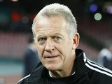 Swansea's Welsh First-Team Coach Alan Curtis looks on before the UEFA Europa League round of 32 second leg football match between SSC Napoli and Swansea City AFC at the San Paolo stadium in Naples on February 27, 2014