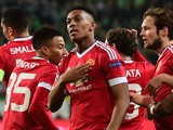 Manchester United's French striker Anthony Martial (c) reacts after scoring the opening goal during the UEFA Champions League Group B second-leg football match VfL Wolfsburg vs Manchester United in Wolfsburg, central Germany, on December 8, 2015.