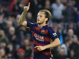 FC Barcelona's Croatian midfielder Ivan Rakitic (R) celebrates a goal during the Spanish league football match FC Barcelona vs Deportivo de La Coruna at the Camp Nou stadium in Barcelona on December 12, 2015