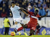 Celta Vigo's Argentinian midfielder Augusto Fernandez (L) vies with Espanyol's Ecuadorian forward Felipe Caicedo during the Spanish league football match Celta Vigo vs Real CD Espanyol at the Balaidos stadium in Vigo on December 12, 2015.