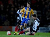 James Collins of Shresbury is challenged by Craig Clay of Grimsby during the Emirates FA Cup second round match between Grimsby Town and Shrewsbury Town at Blundell Park on December 7, 2015