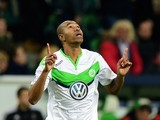 Wolfsburg's Brazilian defender Naldo celebrates scoring during the UEFA Champions League Group B second-leg football match VfL Wolfsburg vs Manchester United in Wolfsburg, central Germany, on December 8, 2015.