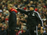 Tony Pulis, manager of West Bromwich Albion points as Jurgen Klopp, manager of Liverpool looks on during the Barclays Premier League match between Liverpool and West Bromwich Albion at Anfield on December 13, 2015 in Liverpool, England.