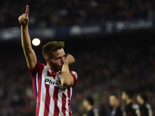 Atletico Madrid's midfielder Saul Niguez celebrates after scoring a goal during the Spanish league football match Club Atletico de Madrid vs Athletic Club Bilbao at the Vicente Calderon stadium in Madrid on December 13, 2015