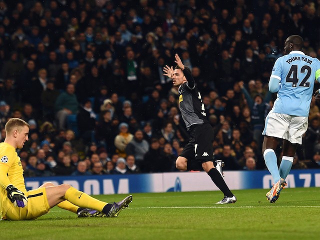 Moenchengladbach's German midfielder Julian Korb (C) celebrates scoring his team's first goal to equalise at 1-1 during the UEFA Champions League Group D football match between Manchester City and Borussia Moenchengladbach at the Etihad Stadium in Manches