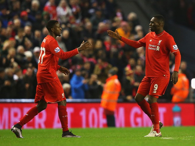 Divock Origi of Liverpool (L) celebrates with Christian Benteke as he scores their second goal during the Barclays Premier League match between Liverpool and West Bromwich Albion at Anfield on December 13, 2015