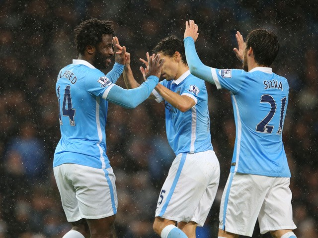 Wilfred Bony (L) of Manchester City celebrates scoring his team's first goal with his team mates Jesus Navas (C) and David Silva (R) during the Barclays Premier League match between Manchester City and Swansea City at Etihad Stadium on December 12, 2015