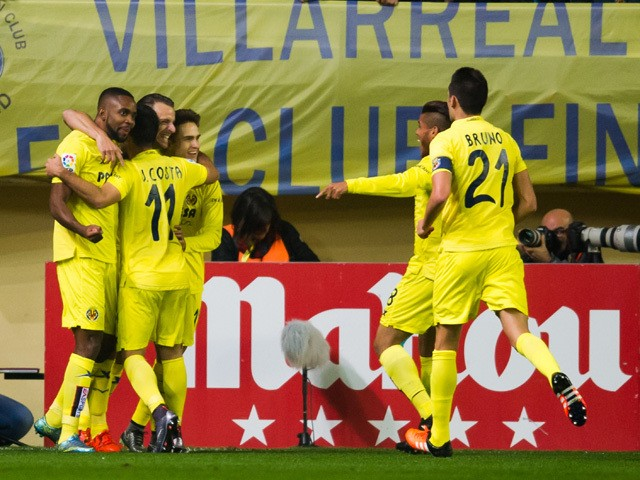 Players of Villarreal CF celebrate after their teammate Roberto Soldado scored the opening goal during the La Liga match between Villarreal CF and Real Madrid CF at El Madrigal on December 13, 2015