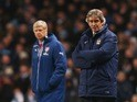 Arsenal manager Arsene Wenger and opposite number Manuel Pellegrini of Manchester City during the Premier League match on January 18, 2015