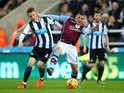 Newcastle's Jack Colback battles with Jordan Veretout of Aston Villa on December 19, 2015