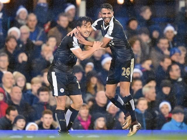 Shinji Okazaki celebrates scoring Leicester's third against Everton with Riyad Mahrez on December 19, 2015