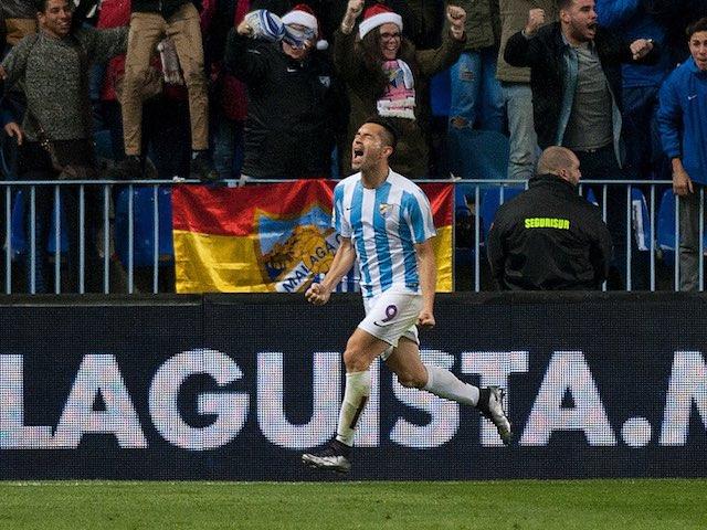'Charles' celebrates scoring for Malaga against Atletico Madrid on December 20, 2015