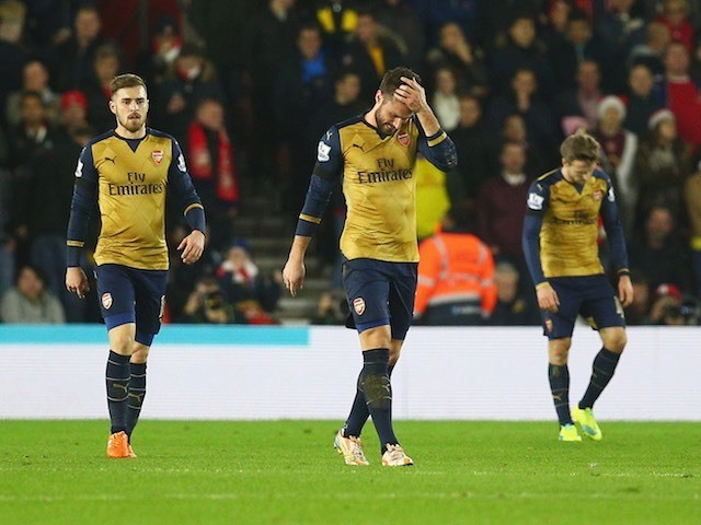 Arsenal teammates Aaron Ramsey, Olivier Giroud and Nacho Monreal react after Southampton score their first on December 26, 2015