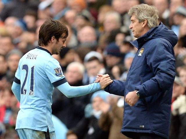 Manchester City's David Silva and Manuel Pellegrini as the player is substituted off against Crystal Palace on December 20, 2014