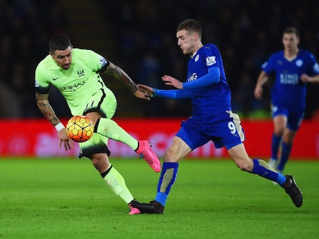 Alexksandar Kolarov and Jamie Vardy in action during the game between Leicester City and Manchester City on December 29, 2015